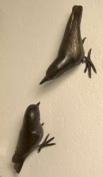 "each bird is about 5"" long.  They can be arranged multiple ways and attach directly to your vertical wall."